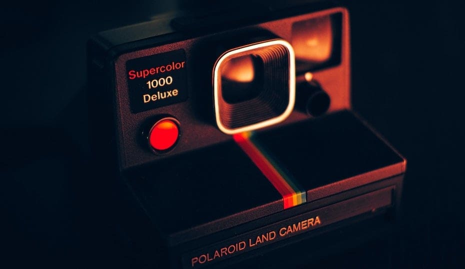 polaroid camera in sunset